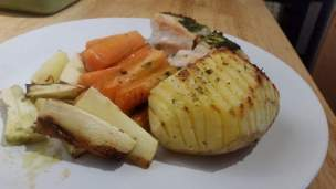 Hasselback Potatoes. Served with pesto baked chicken and roasted root vegetables.